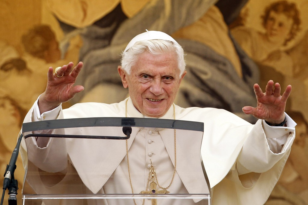Pope Benedict XVI waves as he leads the Angelus from a window at the papal summer residence in Castel Gandolfo, Italy