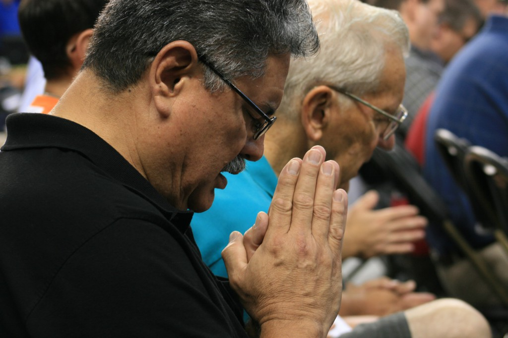 Alfonso G. Martinez Jr., a member of St. Patrick Parish in Fremont, Neb., prays the Our Father Aug. 4 at the Archdiocese of Omaha's third annual Heartland Catholic Men's Conference at D.J. Sokol Arena on the Creighton University campus in Omaha, Neb.