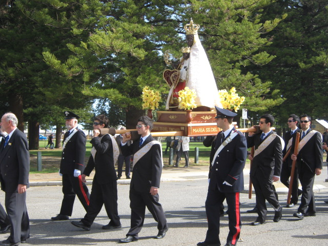 Pole bearers processing with the statue of the Black Madonna