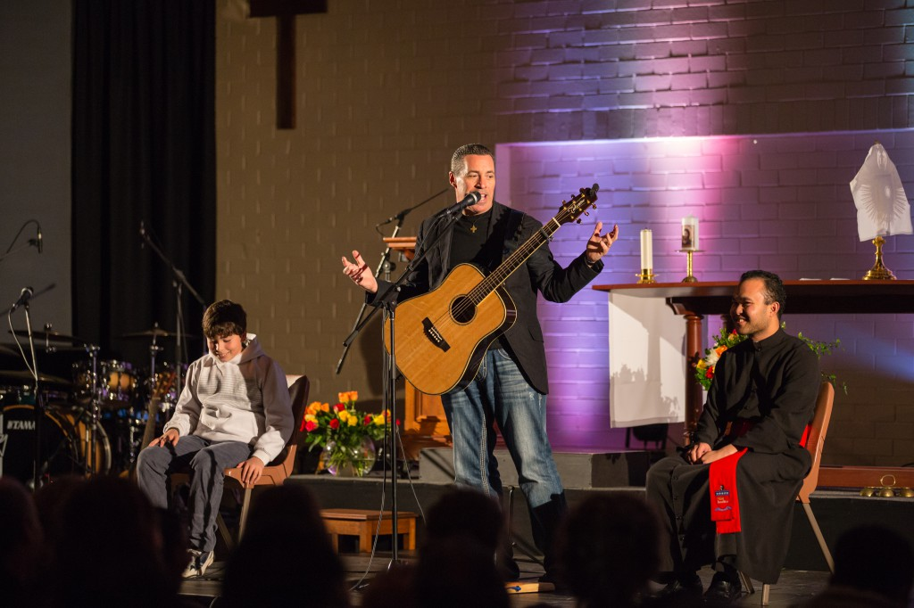 US singer-songwriter Steve Angrisano performs for Perth's youth at Notre Dame University's Drill Hall in Fremantle on the Feast of the Assumption.