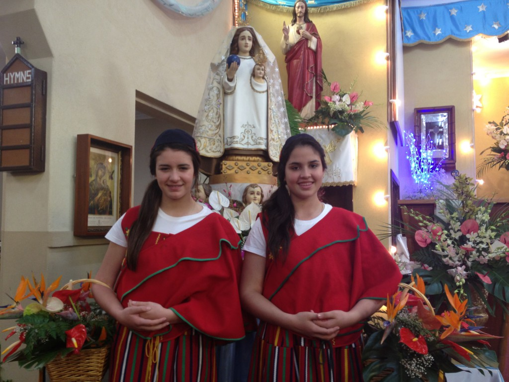 Jessica Romano and Eloise De Aguiar participate in the Feast of Our Lady of the Mount in traditional dress from Portugal 's Madeira Island. PHOTO: Mat De Sousa
