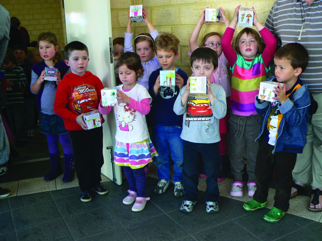Children from Newman College (Kindergarten) get ready to give gifts to Floreat seniors. PHOTO: Floreat Parish