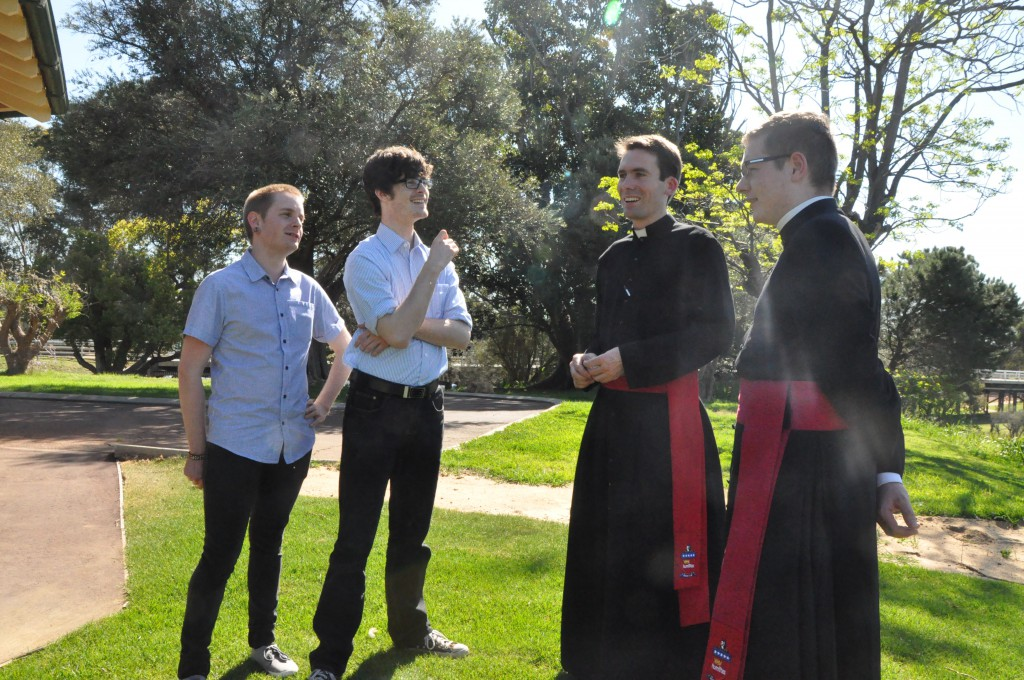 Two seminarians answer questions from some of those visiting St Charles Seminary in Guildford on its open day on Sunday September 16. The day was an opportunity to hear about and get a feel for seminary life. PHOTO: Juanita Shepherd