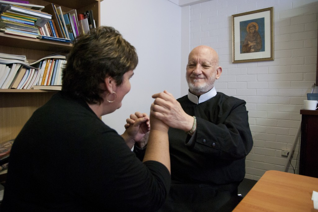 Deaf interpreter, Patricia Levitzke-Gray, communicates questions from Record journalist Mark Reidy to Fr Cyril Axelrod during an interview at The Record's offices.