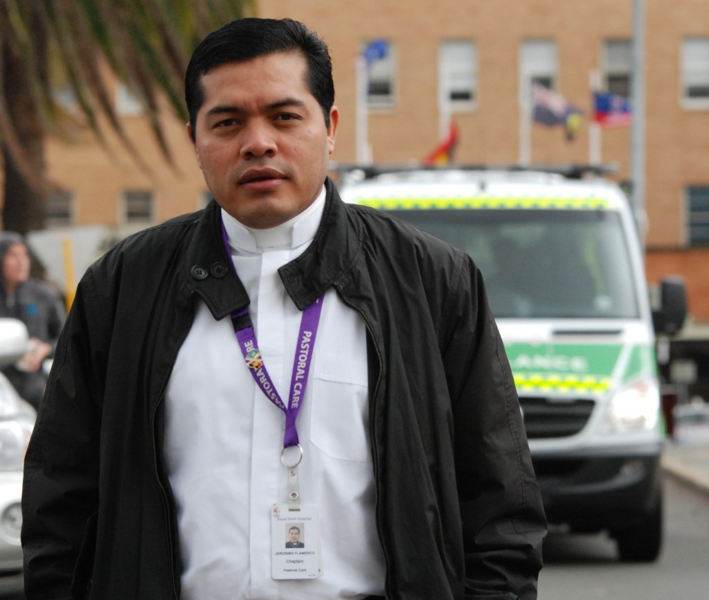 Hospital chaplain Fr Jeronimo stands outside Royal Perth where he is on call 24 hours a day to tend to the sick and dying. PHOTO: Peter Rosengren