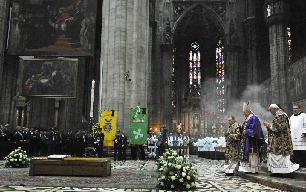 Cardinal Angelo Scola of Milan blesses the casket of Cardinal Carlo Maria Martini during his funeral Mass at the cathedral in Milan on September 3.