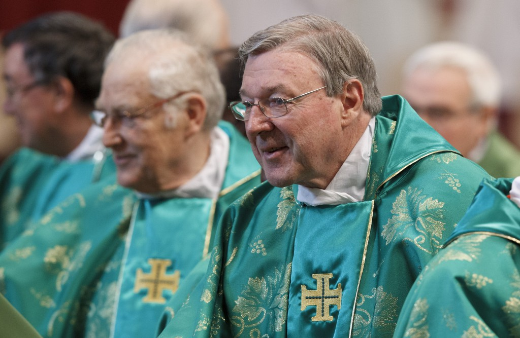 Cardinal George Pell of Sydney prepares to exchange the sign of peace during the closing Mass of the Synod of Bishops on the new evangelisation celebrated by Pope Benedict XVI in St. Peter's Basilica at the Vatican.