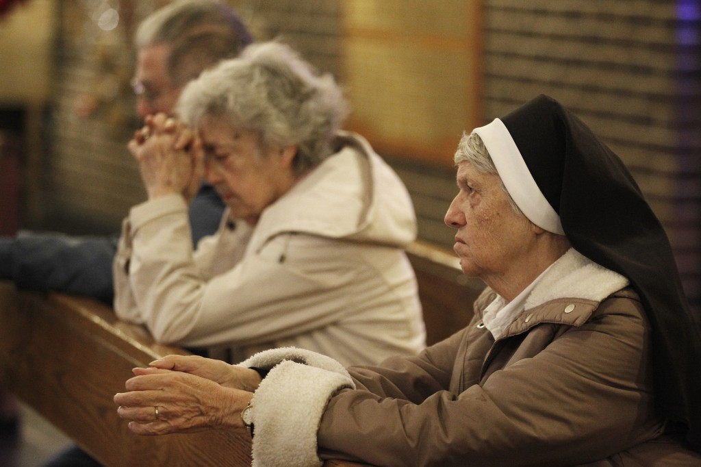 Dominican Sister Jeanine Conlon prays during a Nov. 7 Mass dedicated to people affected by Hurricane Sandy at St. Charles Church in New York's Staten Island.