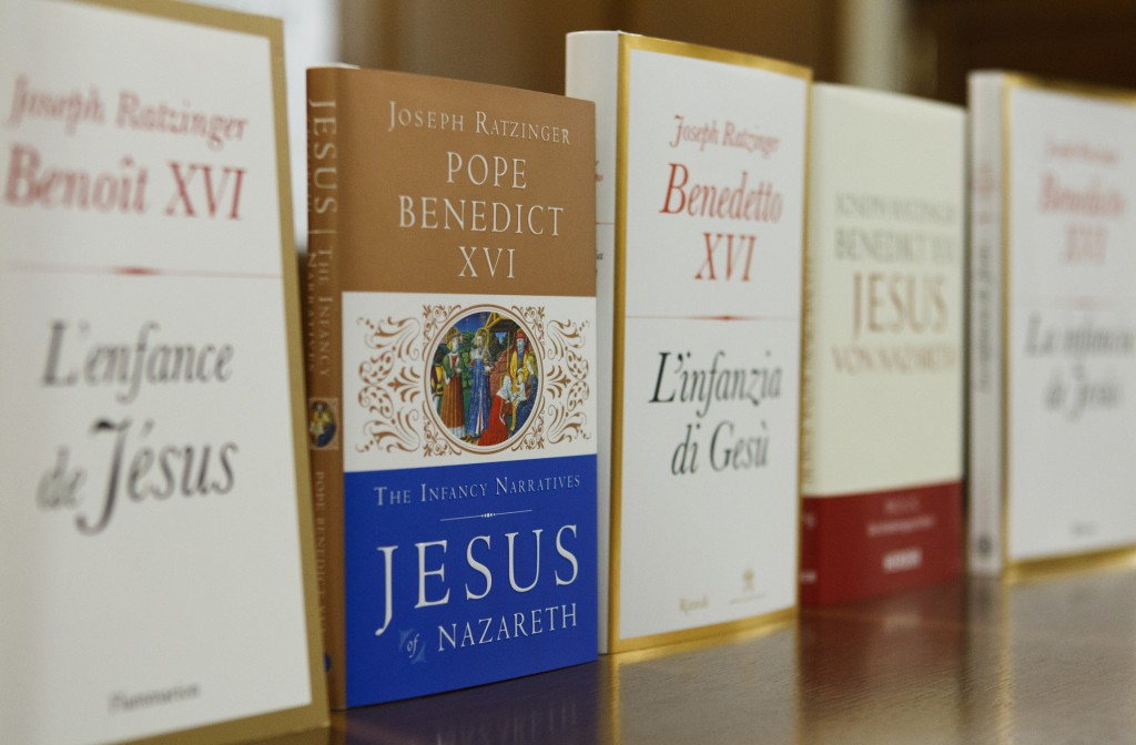 """The English version of Pope Benedict XVI's new book, """"The Infancy of Jesus,"""" is seen among copies in other languages during a press conference for the release of the book to journalists at the Vatican."""