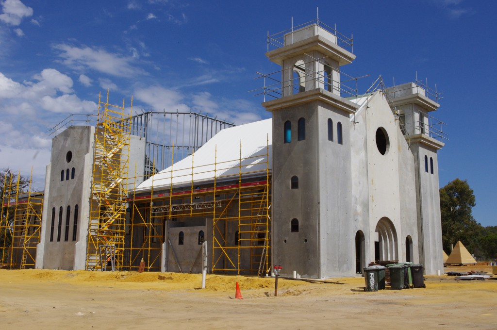 The Romanesque-looking Divine Mercy Church at Maryville Downs near Lower Chittering takes shape and, below, an artist's impression of the finished structure