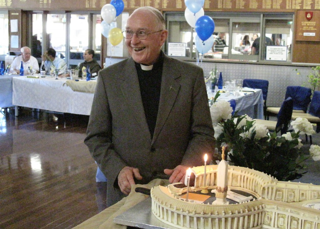 Fr Brian Morgan enjoys the moment and the remarkable 'Vatican' cake at his 80th birthday party.