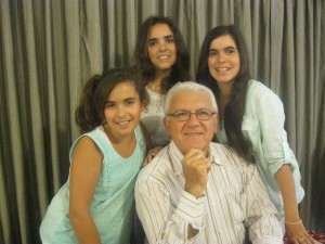 Former steelworker Michael Siciliano with several of his granddaughters. Mr Siciliano. After seeing Fr Rea on October 12 at St MAry's Cathedral in Perth Mr Siciliano is adament he no longer experiences severe back pain.