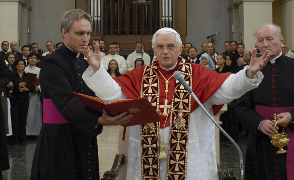 Pope Benedict XVI gives a blessing at the Pontifical Institute of Sacred Music in Rome.