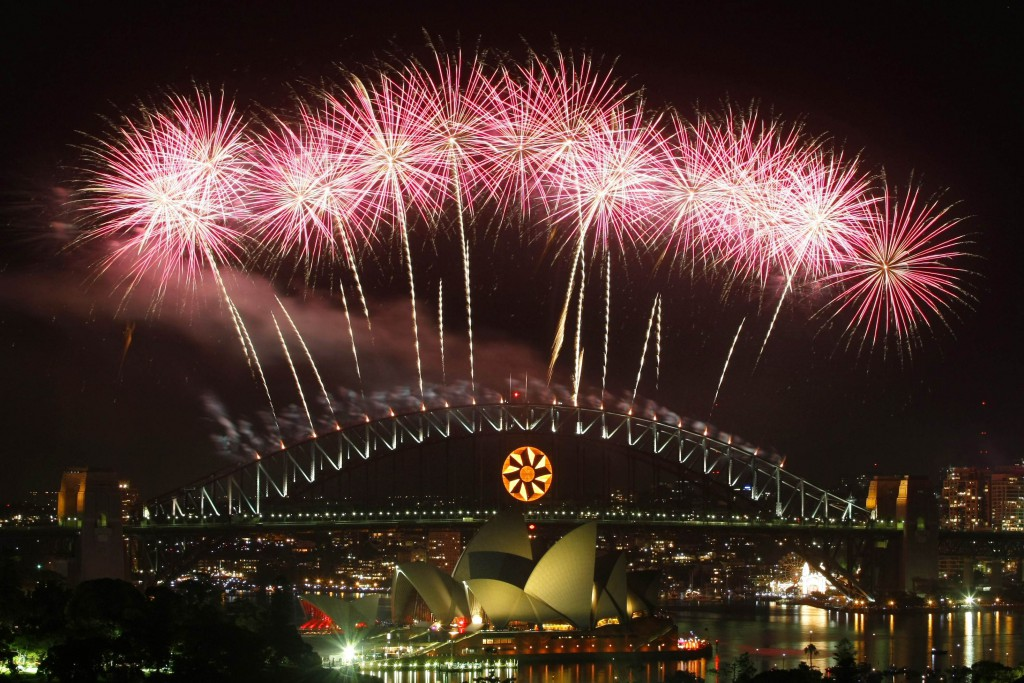 Fireworks explode over the Sydney Harbor Bridge and Opera House during a pyrotechnic show to celebrate the new year.