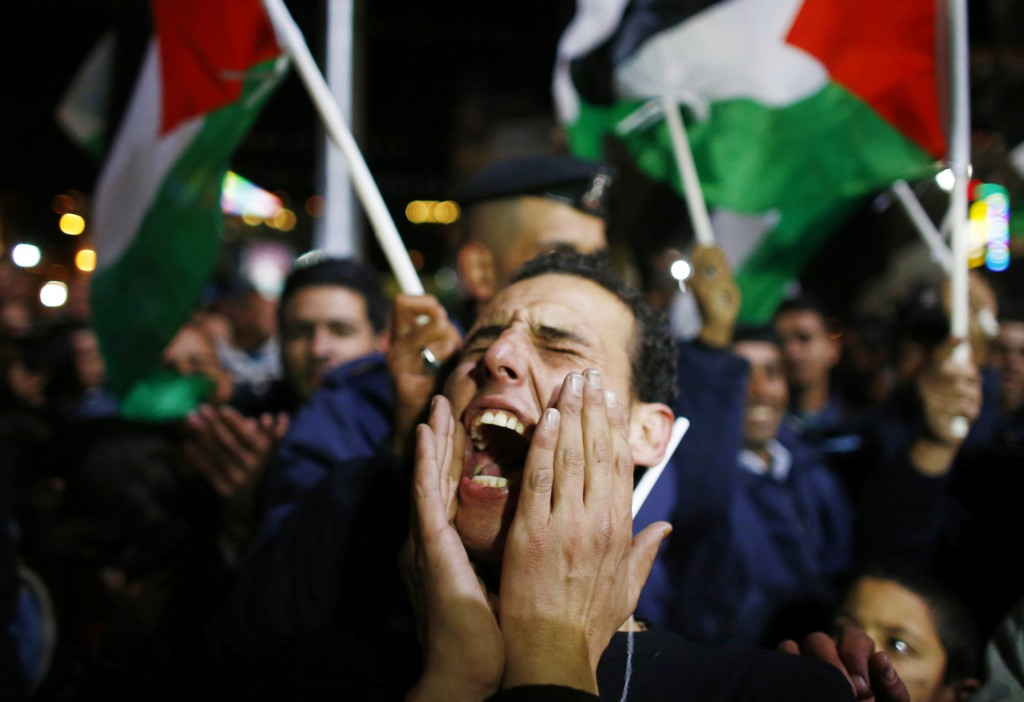 A Palestinian man reacts during a rally in the West Bank city of Ramallah on November 29 when the UN General Assembly approved a resolution to grant Palestine observer status, implicitly recognising a Palestinian state.