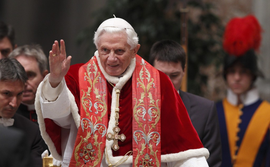Pope Benedict XVI waves as he arrives to make remarks at the conclusion of the opening Mass of the International Congress on the Church in America held in St Peter's Basilica at the Vatican on December 9.