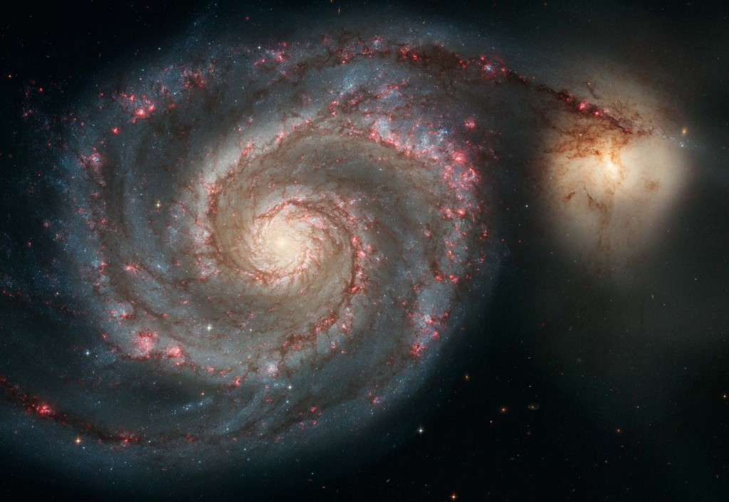 The Whirlpool galaxy and the Companion galaxy are seen in this image taken by the Hubble Space Telescope. Recent discoveries now mean science has to acknowledge the universe had a beginning, says philosopher Fr Spitzer, a Jesuit. Problem for atheists: that means a creator too.