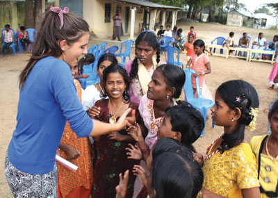 Year 11 Servite Student, Georgia Seragusana, is greeted by children at a Servite parish picnic in Chennai.