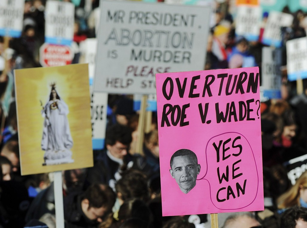 A woman holds a sign mocking U.S. President Barack Obama during the March for Life rally in 2009 on the National Mall in Washington. PHOTO: CNS/Jonathan Ernst, Reuters