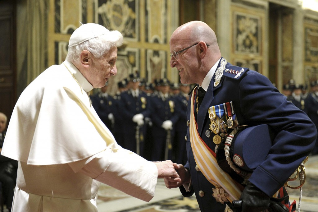 Pope Benedict XVI greets Domenico Giani, the Vatican police chief, during a private audience at the Vatican on January 11. PHOTO: CNS/L'Osservatore Romano