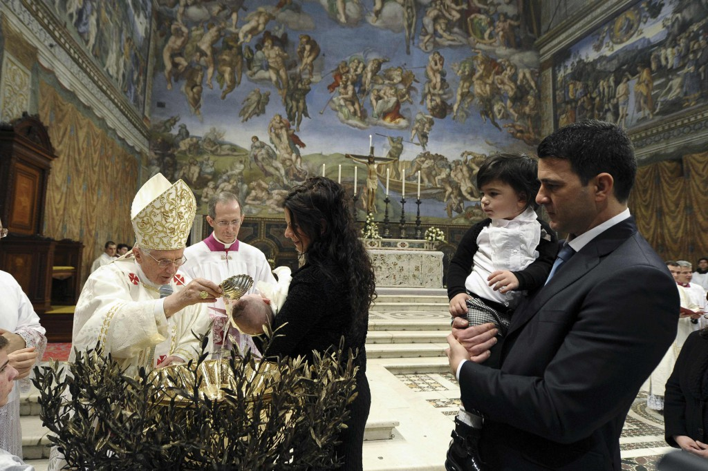 "Pope Benedict XVI baptises a baby during a Mass in the Sistine Chapel at the Vatican on January 13. The Pope baptised 20 babies as he celebrated the feast of the Baptism of the Lord. The Pontiff told parents that baptism would bring their child into a ""personal relationship with Jesus"" that would give their lives meaning. PHOTO: CNS/L'Osservatore Romano"