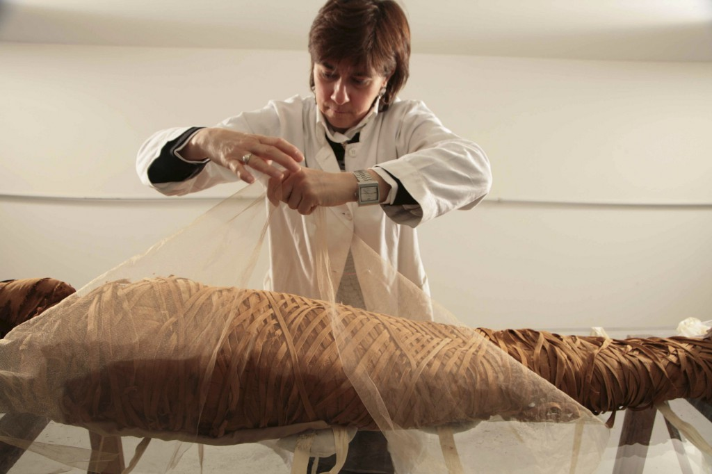 Cinzia Oliva, a textile restorer from Turin, Italy, who specialises in mummy wrappings, puts the finishing touches on restoring the mummy Ny-Maat-Re in the Vatican Museums' collections. PHOTO: Vatican Museums