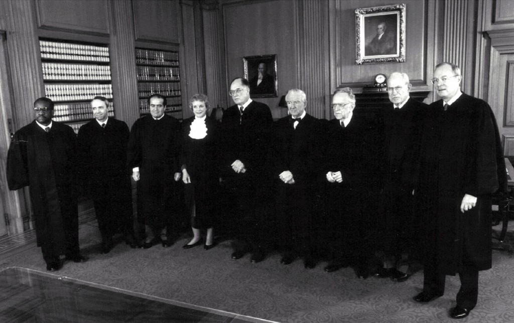 Retired Supreme Court Justice Byron White, second from right, poses in this 1991 with the U.S. Supreme Court justices. PHOTO: CNS