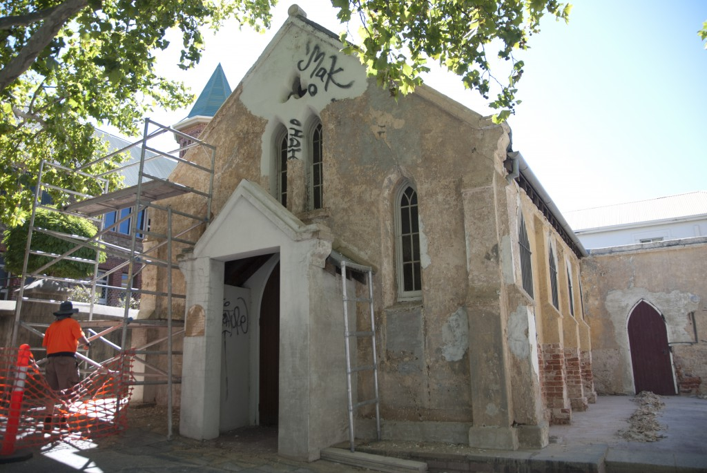 St John's Pro-Cathedral in inner city Perth this week, stripped of much of its exterior surface and revealing original brickwork. PHOTO: Matthew Biddle
