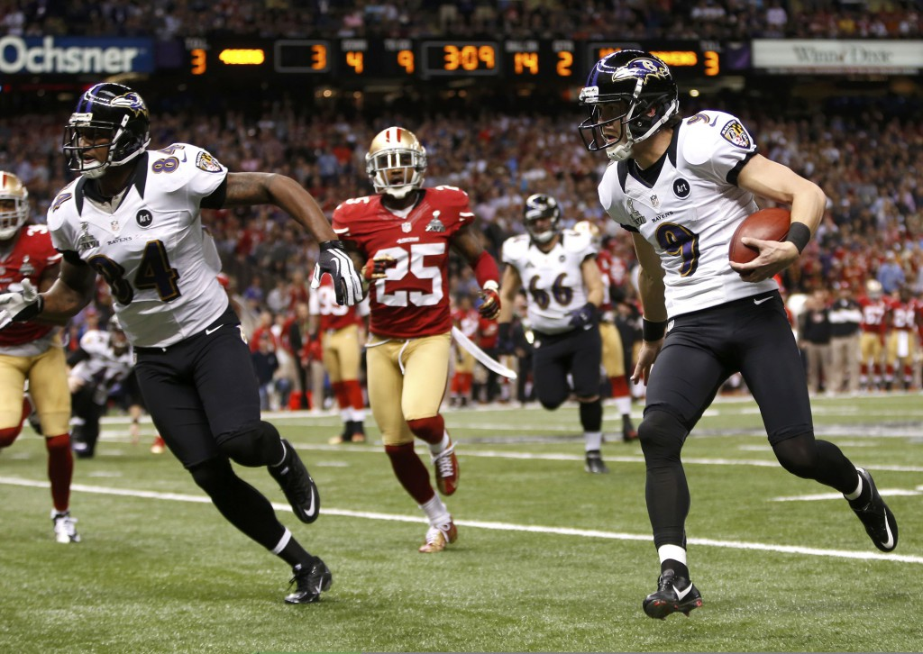 Baltimore Ravens kicker Justin Tucker attempts a first down on a fake kick against the San Francisco 49ers during the second quarter of the NFL Super Bowl XLVII football game on Feb. 3 in New Orleans. PHOTO: CNS/Mike Segar, Reuters