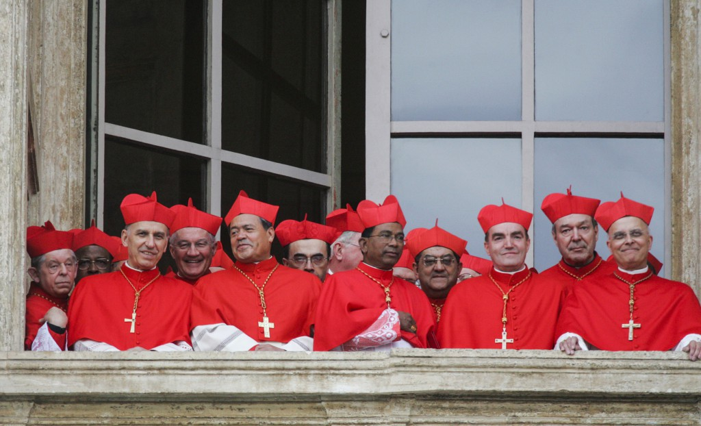 Cardinals gather on a side balcony of St. Peter's Basilica as they await the public introduction of the new pope in this April 19, 2005. German Cardinal Joseph Ratzinger was elected the 265th pope and chose the name Benedict XVI. PHOTO: CNS/Nancy Wiechec