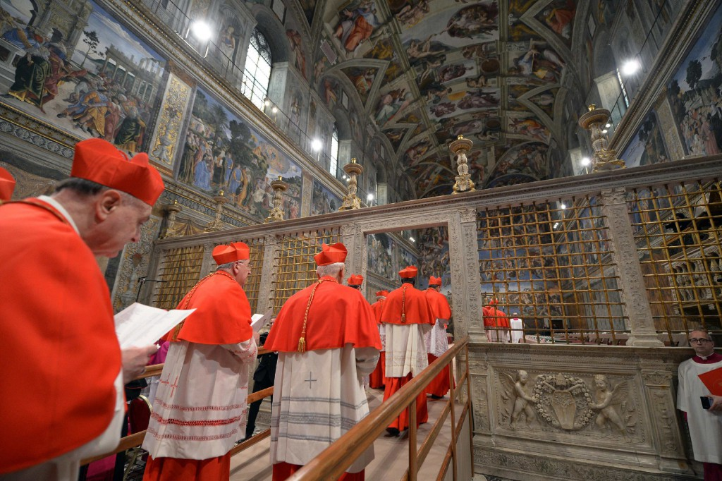Cardinals from around the world enter the Vatican's Sistine Chapel on March 12 as they begin the conclave to elect a successor to Pope Benedict XVI. PHOTO: CNS/L'Osservatore Romano via Reuters