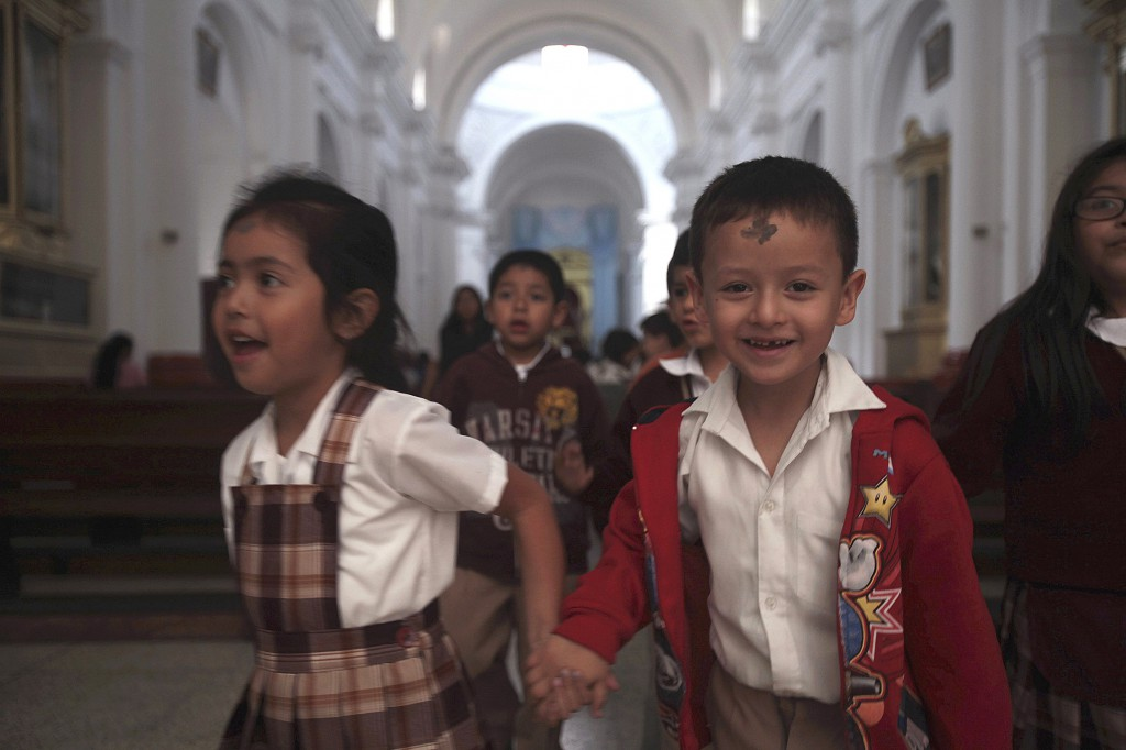 Children exit a church after receiving ashes during an Ash Wednesday Mass on Feb. 13 in Guatemala City. PHOTO: CNS/Joe Penney, Reuters