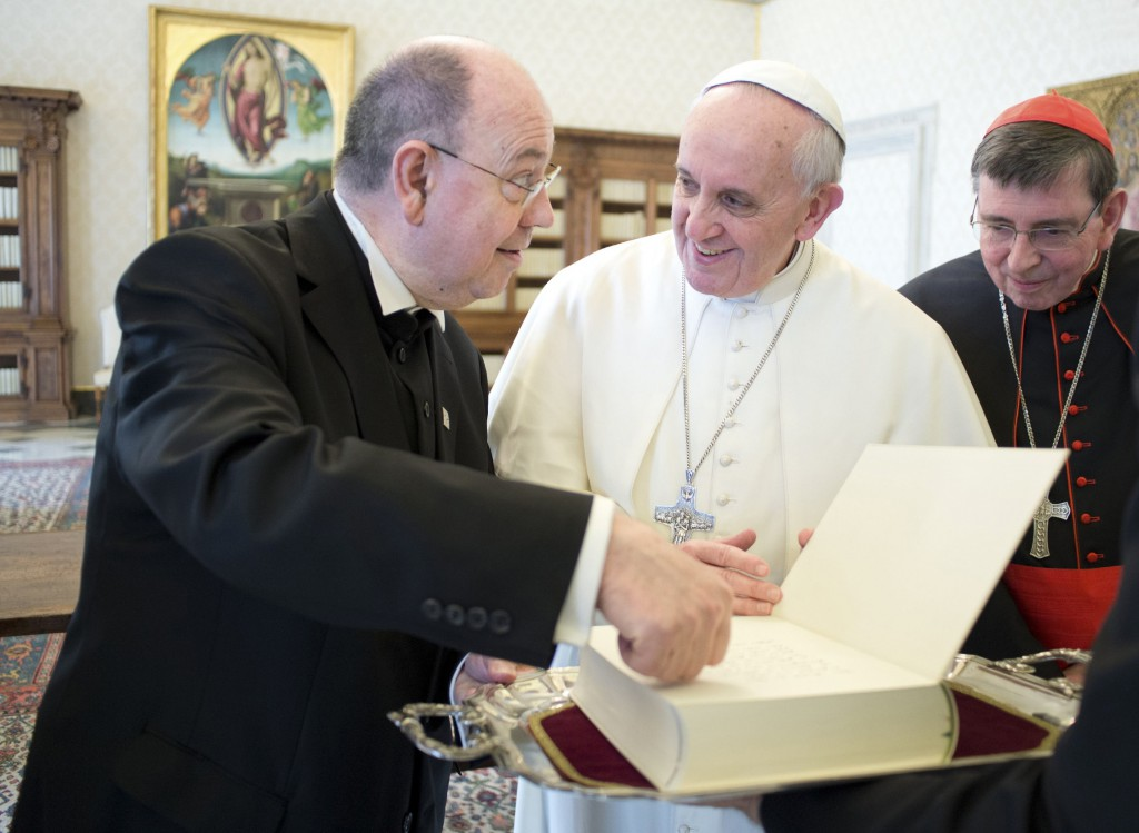 Pope Francis receives a book from the Rev. Nikolaus Schneider, president of the Council of the Evangelical Church in Germany, during a meeting on April 8 at the Vatican. PHOTO: CNS/L'Osservatore Romano via Reuters