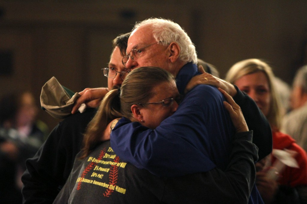 Residents embrace after taking part in a candlelight vigil April 18 at the Church of the Assumption in West, Texas, in remembrance of those who lost their lives or were injured in the massive explosion at the area's fertilizer plant. PHOTO: CNS/Jaime R. Carrero, Reuters
