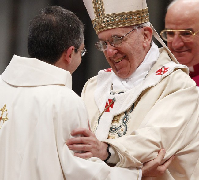 Pope Francis embraces one of the 10 priests he ordained on April 21 in St. Peter's Basilica at the Vatican. PHOTO: CNS/Paul Haring