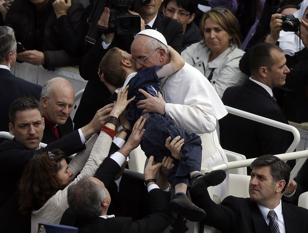 Pope Francis lifted Dominic, who has cerebral palsy, while embracing and kissing him. He also spoke to the boy before gently placing the child back into his mother's arms.