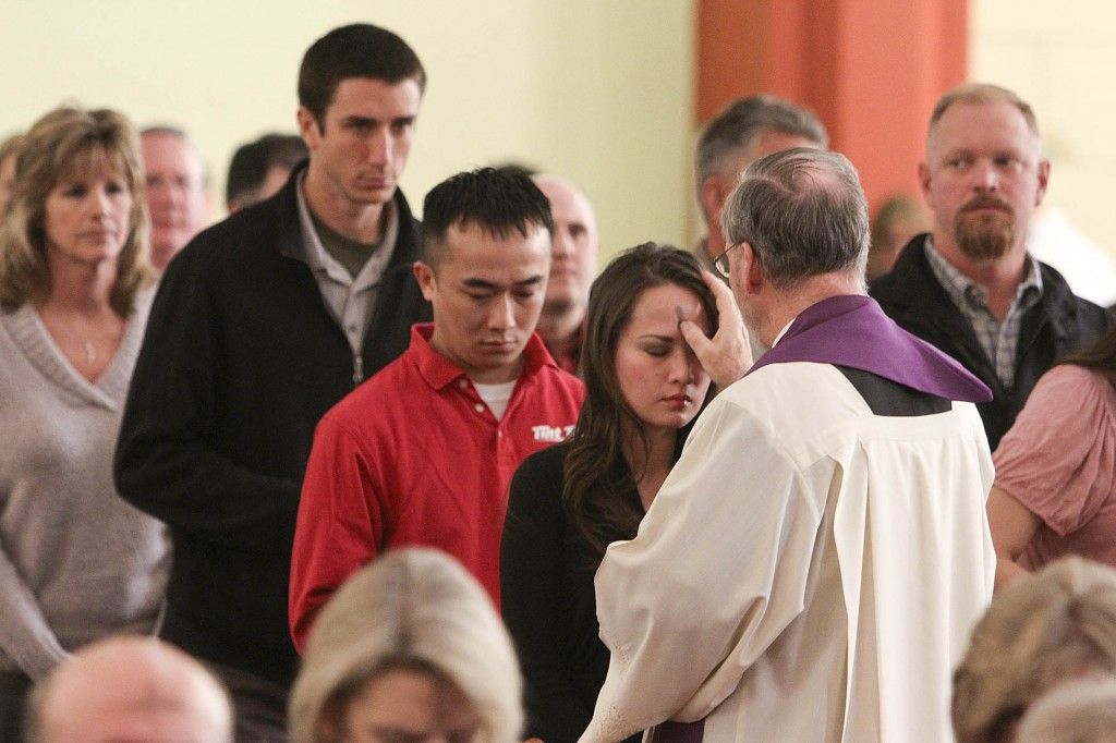 Woman recives ashes from priest during 2012 Ash Wednesday service at Oklahoma church
