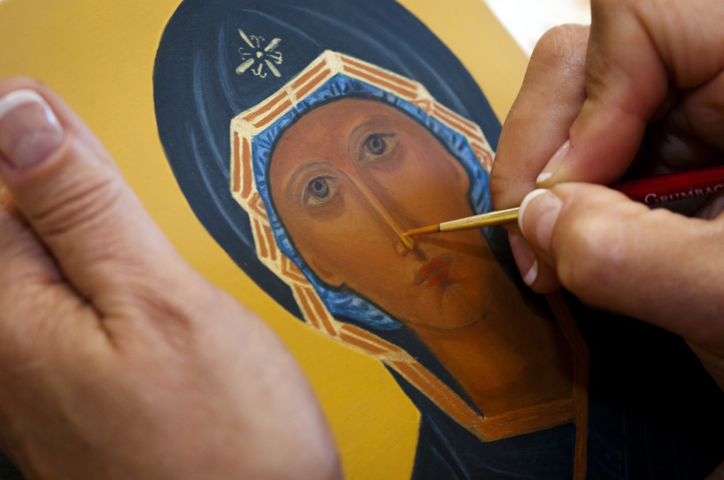 Teresa Foley paints detail on her icon of the Mother of God of the Sign May 25 at the home of iconographer Veronica Royal in Annandale, Va. Royal teaches iconography at her parish and home, promoting an ancient craft and infusing students with a sense of sacred art. PHOTO: CNS/Nancy Phelan Wiechec