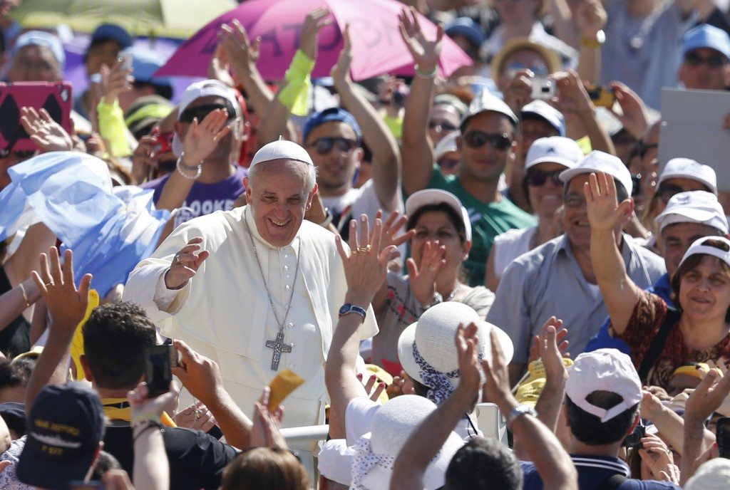 Pope Francis greets the crowd as he arrives to lead his general audience on June 19 in St. Peter's Square at the Vatican. PHOTO: CNS/Paul Haring