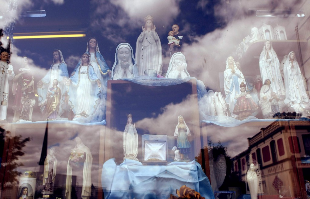 Religious statues are displayed in a shop in Knock, Ireland. PHOTO: CNS/Cathal McNaughton, Reuters