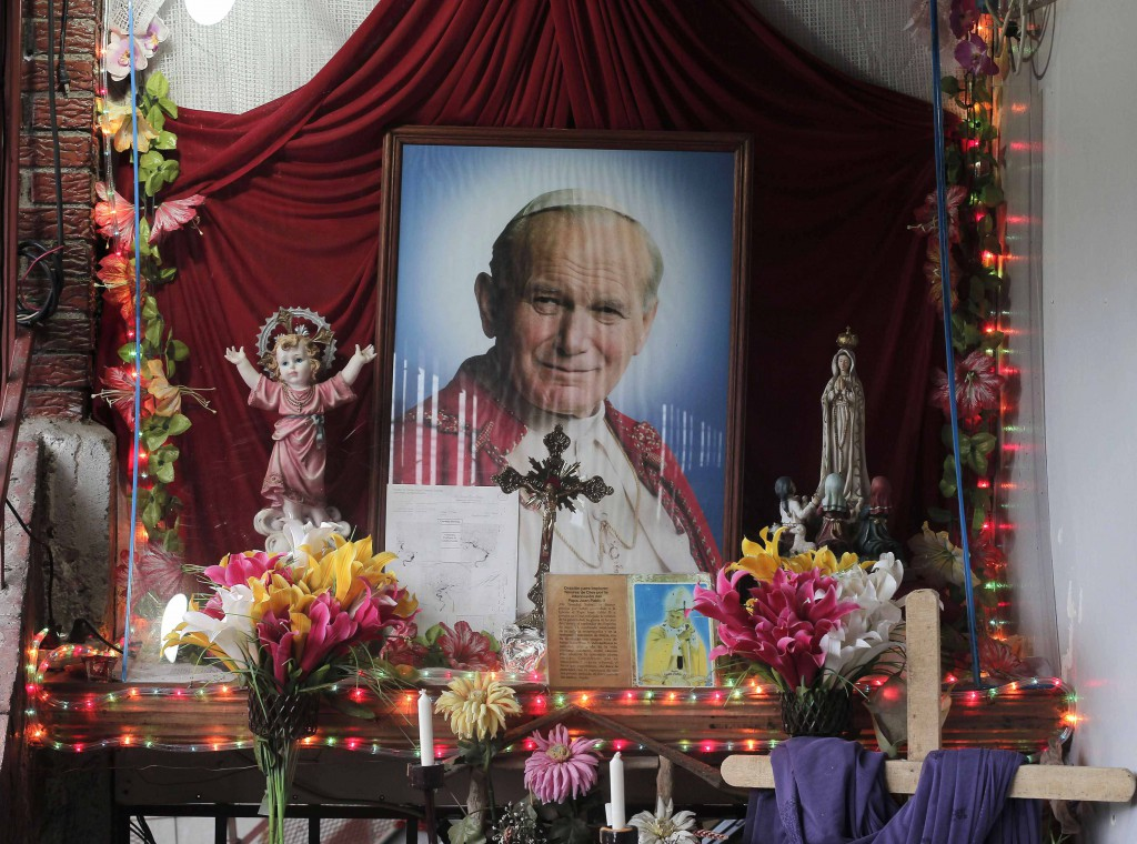 An altar containing images of Blessed John Paul II is pictured in the house of Floribeth Mora Diaz, the Costa Rican woman whose inexplicable cure has been attributed to the intercession of the late Polish pontiff, July 4 in Cartago, Costa Rice. The Vatican announced July 5 that Pope Francis has signed the decree approving his sainthood. PHOTO: CNS/Juan Carlos Ulate