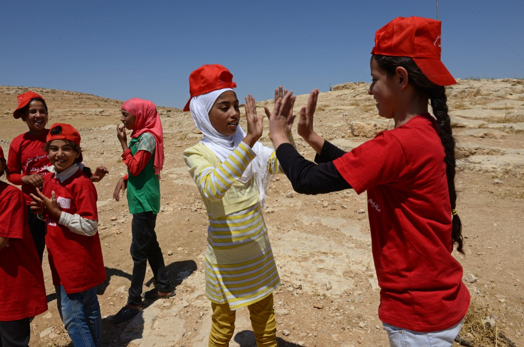 Girls from the South Hebron Hills play a game at a summer camp in the West Bank village of Tuba June 28. The camp is a welcome break for Palestinian children caught in the upheaval of Palestinian-Israeli frictions. PHOTO: CNS/Debbie Hil