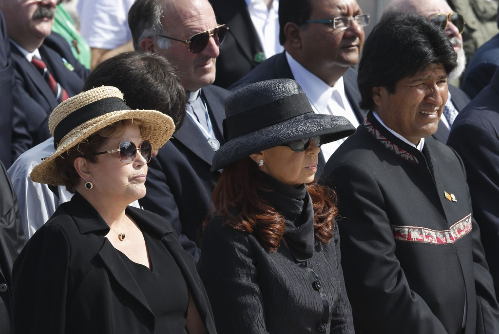 Brazil's President Dilma Rousseff, left, stands with Argentina's President Cristina Fernandez de Kirchner and Bolivia's President Evo Morales on July 28 at the closing Mass of World Youth Day celebrated by Pope Francis on Copacabana beach in Rio de Janeiro. PHOTO: CNS/Paul Haring