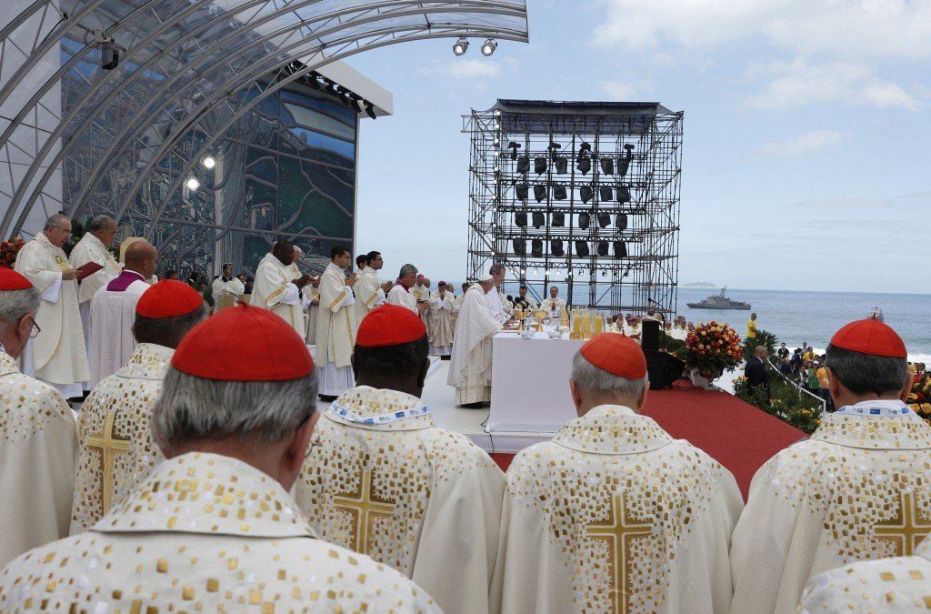 Cardinals stand beside the altar on July 28 as Pope Francis celebrates the closing Mass of World Youth Day on Copacabana beach in Rio de Janeiro.  PHOTO: CNS/Paul Haring
