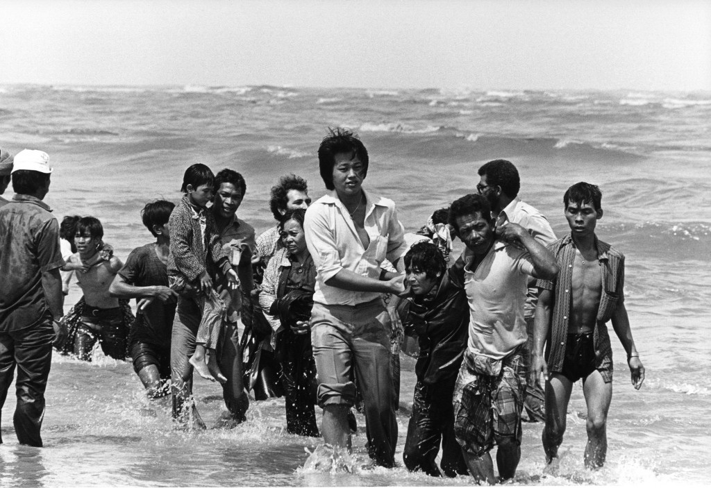 A picture taken in the late 1970s shows a group refugees (162 persons) arrived on a small boat which sank a few meters from the shore in Malaysia.