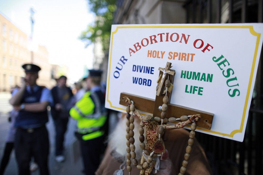 A sign with a crucifix and rosary are seen during a pro-life demonstration July 10 outside the Irish Parliament in Dublin ahead of a vote to allow limited abortion in Ireland. PHOTO: CNS/Cathal McNaughton, Reuters