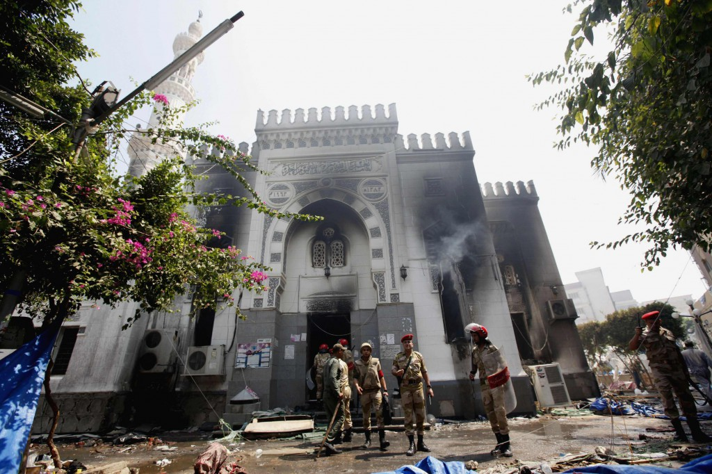 Military police stand outside the burned Rabaa Adawiya mosque Aug. 15, the morning after the clearing of a protest which was held around the mosque in Cairo. Egyptian authorities significantly raised the death toll from nationwide clashes between police and supporters of the ousted Islamist President Mohammed Morsi, saying more than 500 people died. PHOTO: CNS/Mohamed Abd El Ghany, Reuters