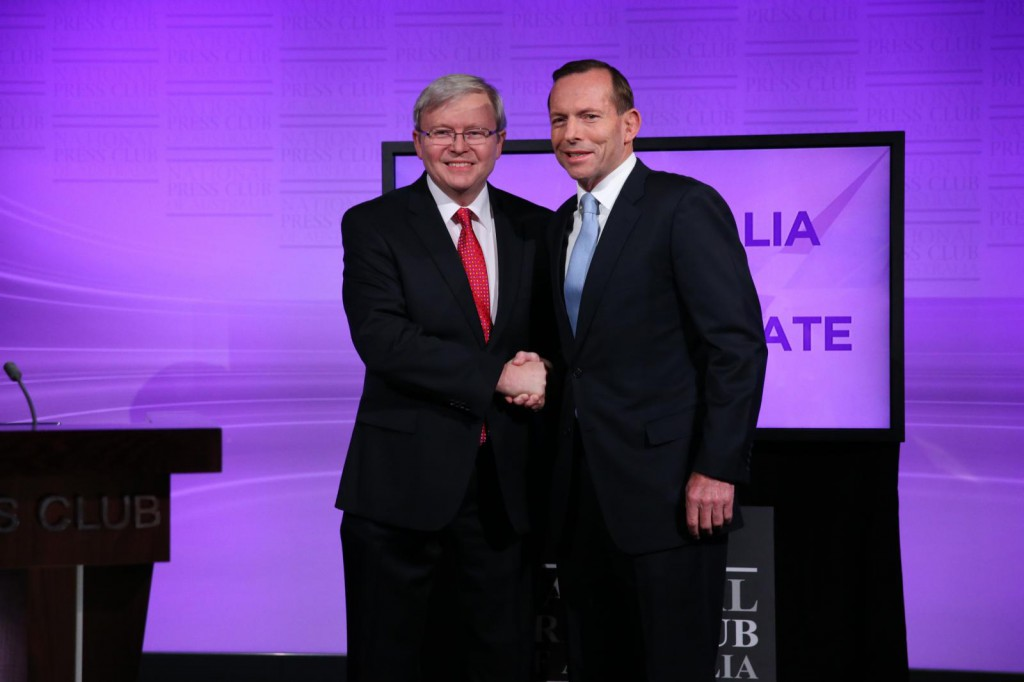 Prime Minister Kevin Rudd and Opposition Leader Tony Abbott shake hands at the commencement of the Leaders Debate at the National Press Club on August 11, 2013 in Canberra, Australia. PHOTO: Gary Ramage-Pool/Getty Images