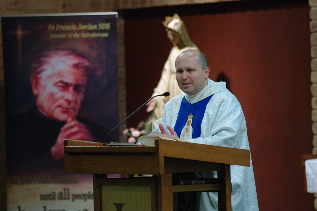 Fr Karol Kulczycki SDS, superior of the Salvatorians, preaches with an image of Salvatorian founder Fr John Baptist Jordan SDS in the background.