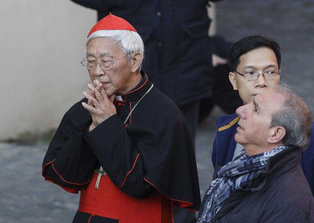 Cardinal Joseph Zen Ze-kiun, retired archbishop of Hong Kong, prays before Pope Benedict XVI's final public appearance as pope at Castel Gandolfo, Italy, Feb. 28. The Asian church news portal ucanews.com reported that Cardinal Joseph Zen Ze-kiun issued the request for a symbolic mooncake donation to prisoners in Hong Kong to Pope Francis in August. PHOTO: CNS/Paul Haring